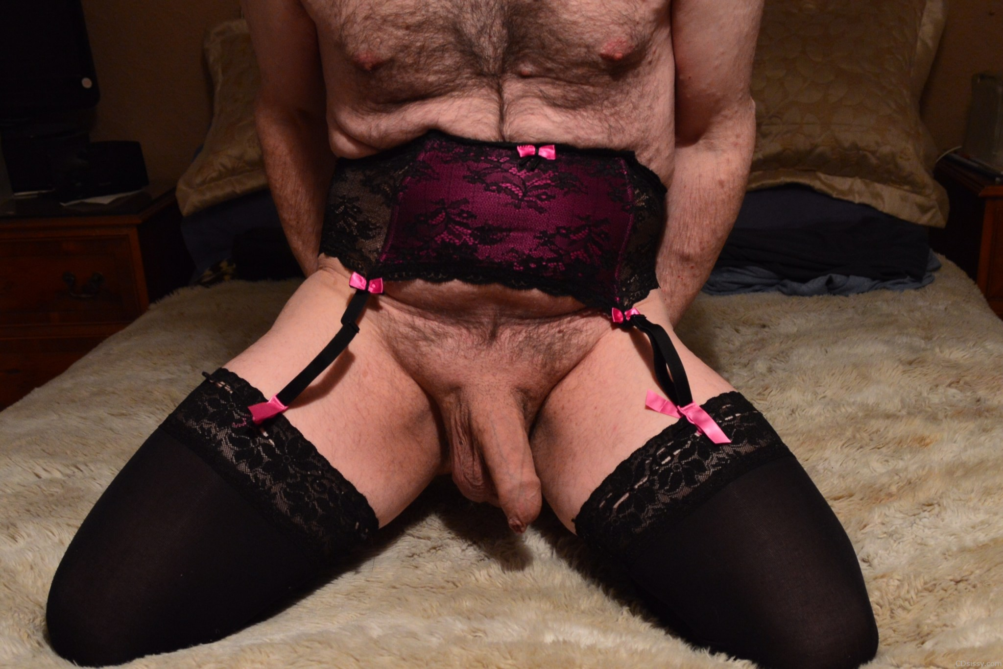Horny sissy on the bed